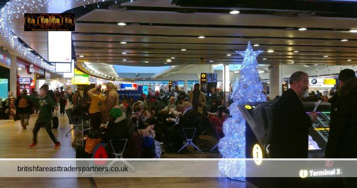HAPPY HOLIDAYS!!! LONDON HEATHROW AIRPORT FEELING VERY FESTIVE INDEED!